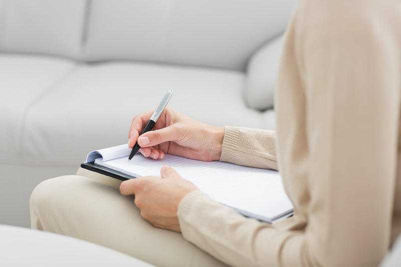 woman is making notes in her notebook