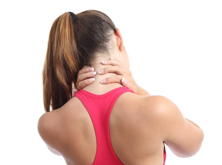 a woman is holding her neck in pain
