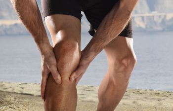Man Grabbing His Knee in Pain